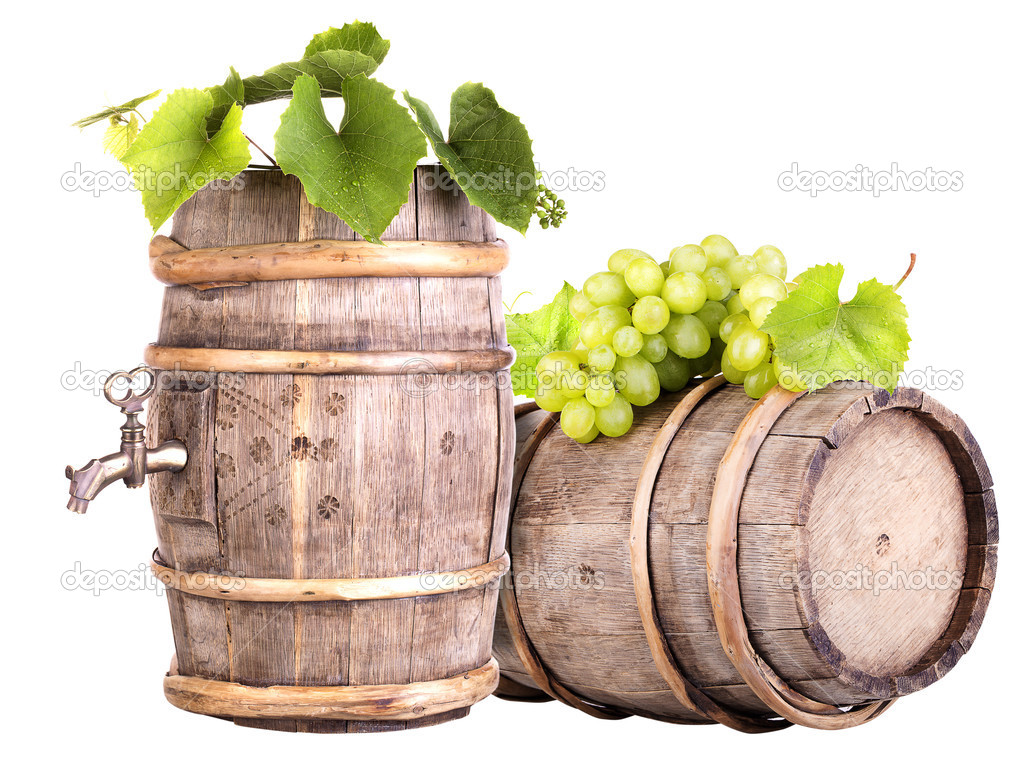 Grapes and wooden vintage barrel