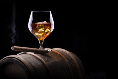 Cognac and Cigar on black with vintage barrel