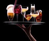 Fotografie Sada s různých nápojů na černém pozadí
