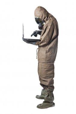 Man in Hazard Suit using a laptop