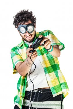 A guy wearing casual clothes and on old pair of goggles over a white bachground and using a gamepad controller stock vector