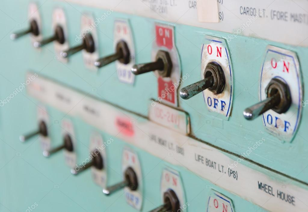 Close up shot of toggle switch on off button panel on cargo vessel