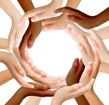 Conceptual symbol of multiracial human hands making a circle on