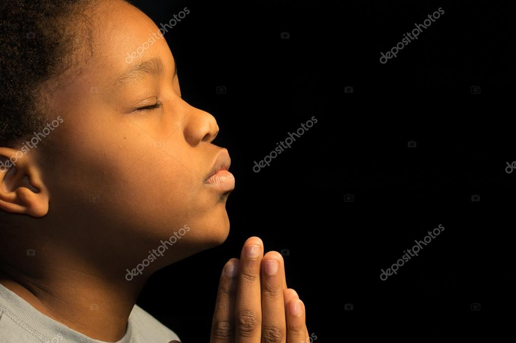 Praying African American boy stock vector