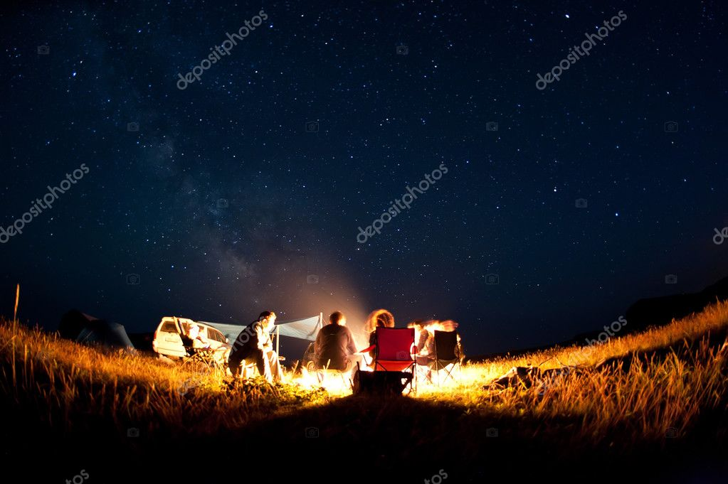 camping fire under the stars