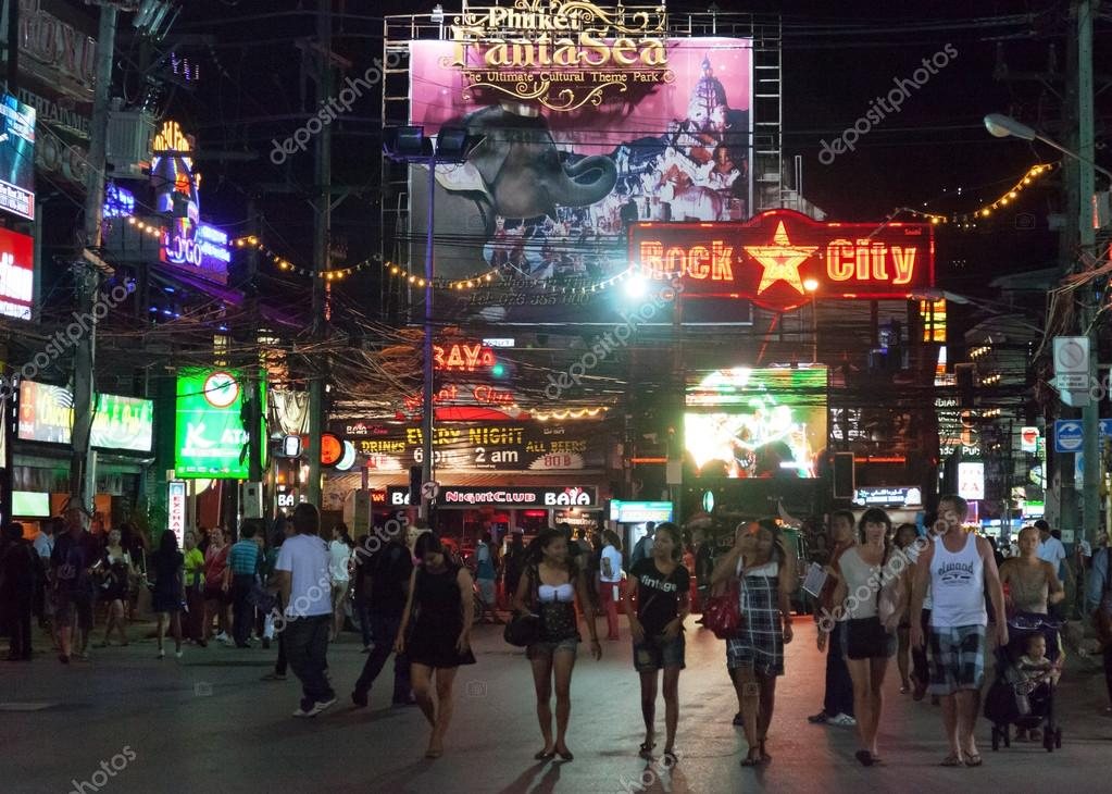 PATONG, THAILAND - APRIL 26, 2012: People walk in the evening on