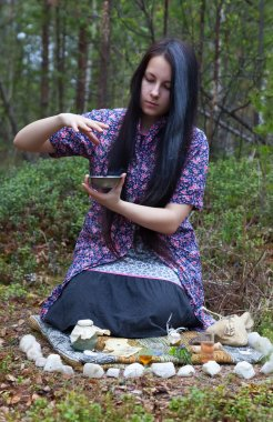 Girl witch conjures in the woods