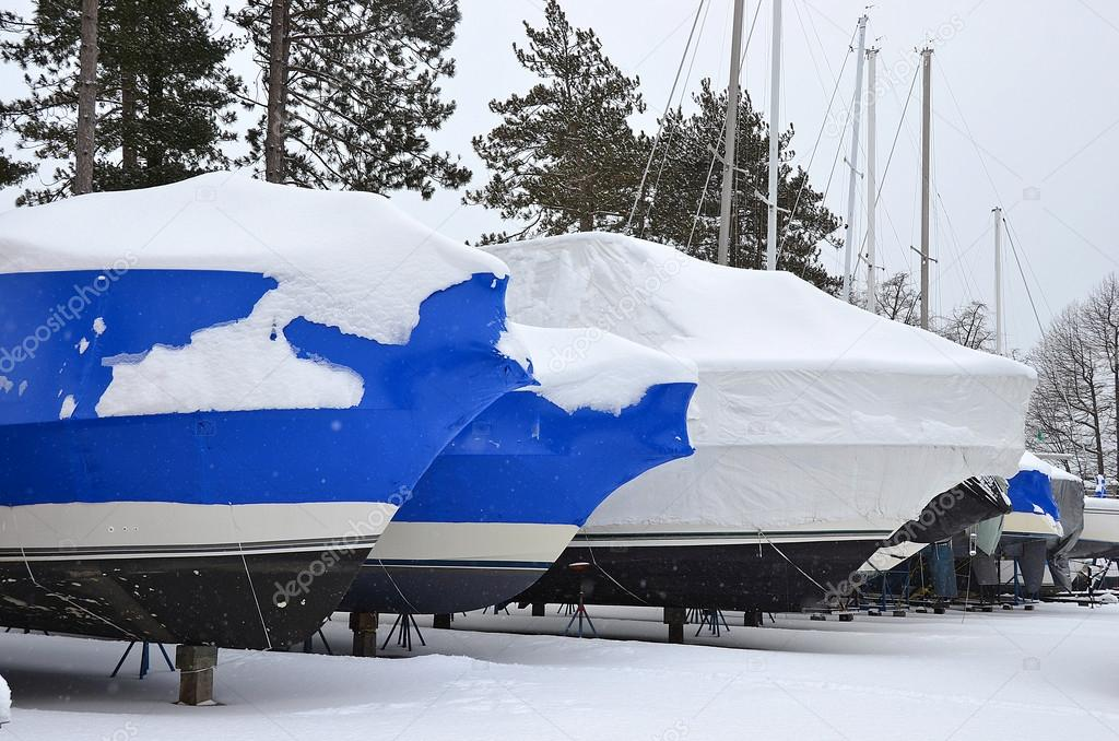 shrink wrapped boats in snow
