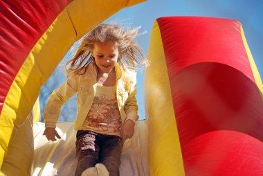 happy little girl on a slide