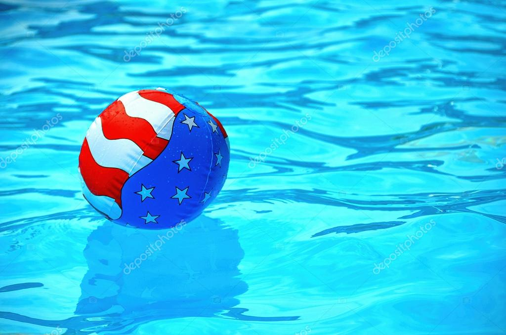 Pool Water With Beach Ball patriotic beach ball in swimming pool — stock photo © jentara