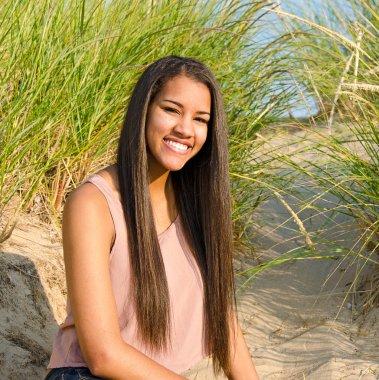 Beautiful teenage girl in grass