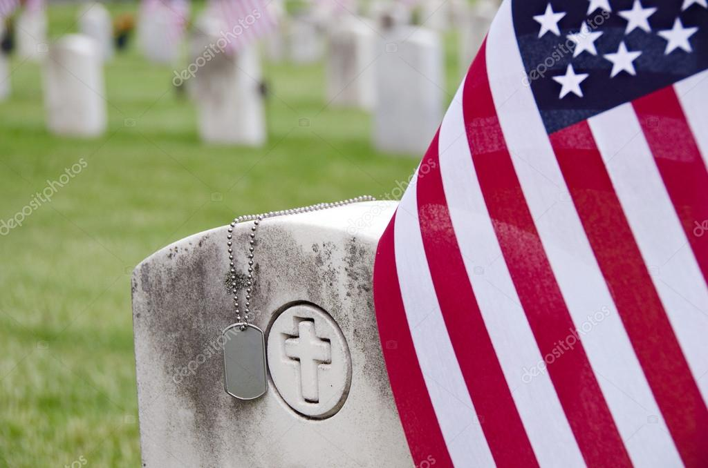 Military dog tags on tombstone