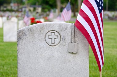 Dog tags on veteran's tombstone