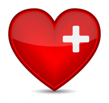 First aid medical sign on red heart shape.