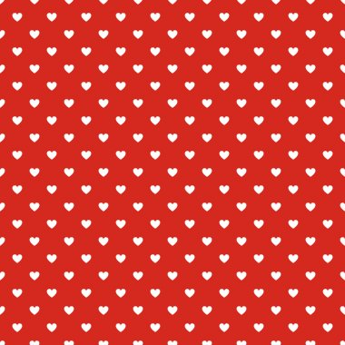 Seamless polka dot red pattern with hearts.