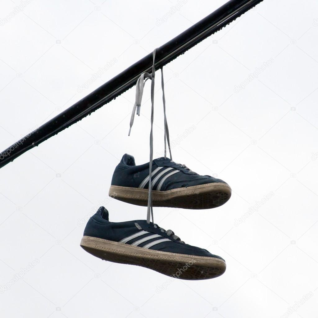 Shoes hanging on a wire stock photo premek 26635763 for Hang photos from wire