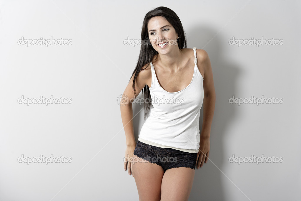 30d91ca45 Woman in white vest top — Stock Photo · Beautiful young woman in underwear  leaning against a wall — Photo by ...