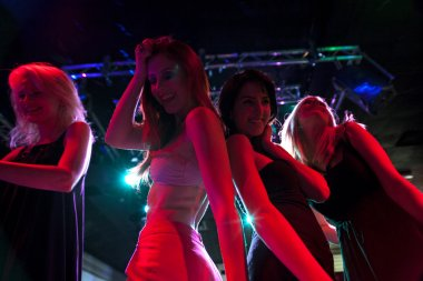 Group of friends dancing at a club