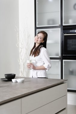 Woman in her stylish kitchen