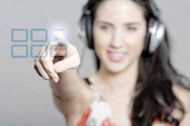 Woman choosing song from playlist