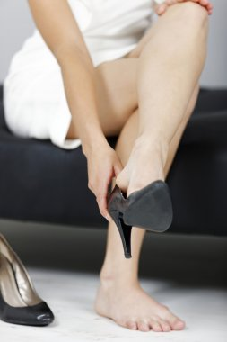 Woman taking her shoes off