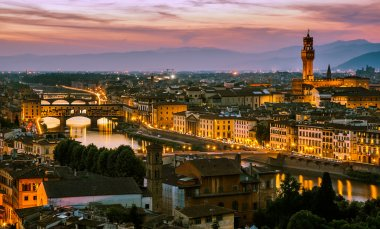 Night view over Arno river in Florence, Italy