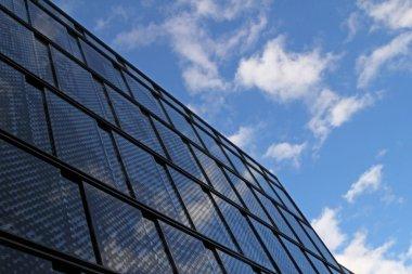 Glass building against blue sky