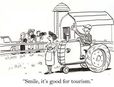 Farmer and wife smile for tourists.