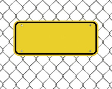 Yellow plate on a wire fence