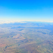 Beautiful view from the aircraft to the clouds and the earth