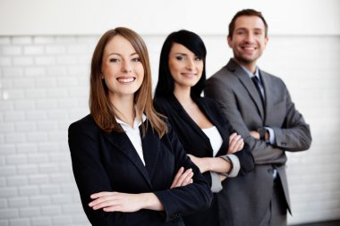 Three business smiling