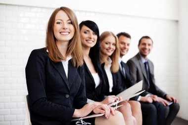 Successful businesswoman in group of