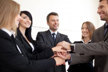Happy Business team joining hands