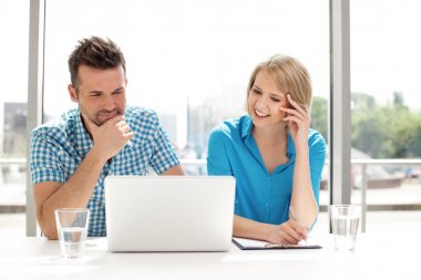 Couple discussing new project on the laptop