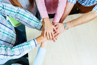 Group of corporate people joining hands