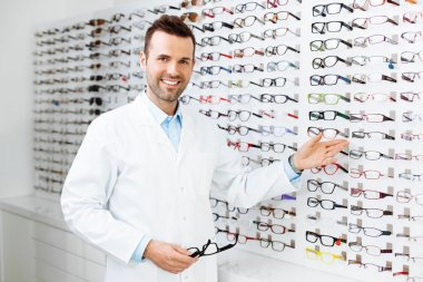 Optician selling glasses