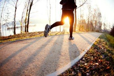 Man running at autumn