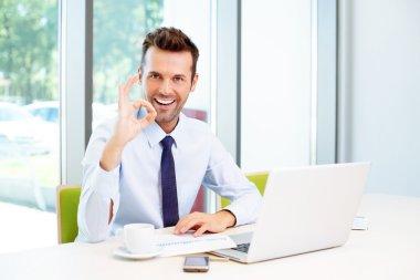 Businessman gestures perfect sign