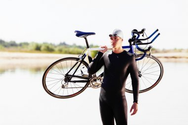 Triathlonist preparing for bike race
