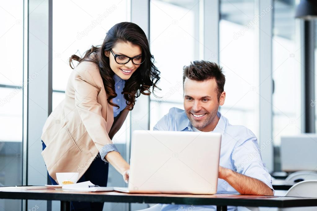 Business partners at front of laptop