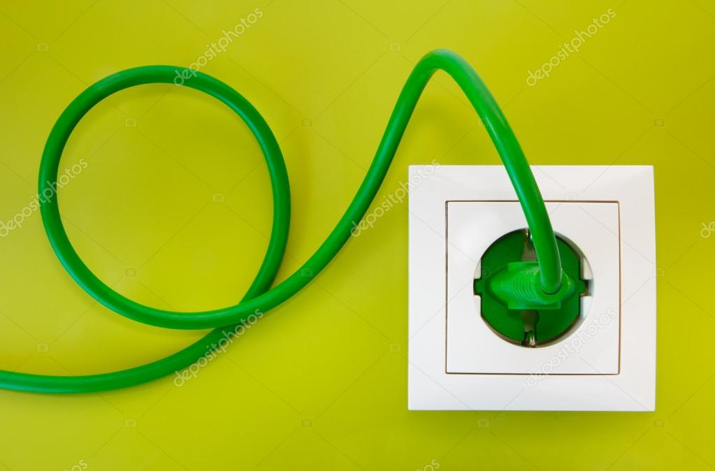 Green power plug into white power socket