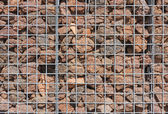 Photo Gabion wall filled with lava stones