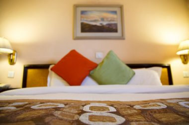 Warmly lit hotel room with shallow depth of field
