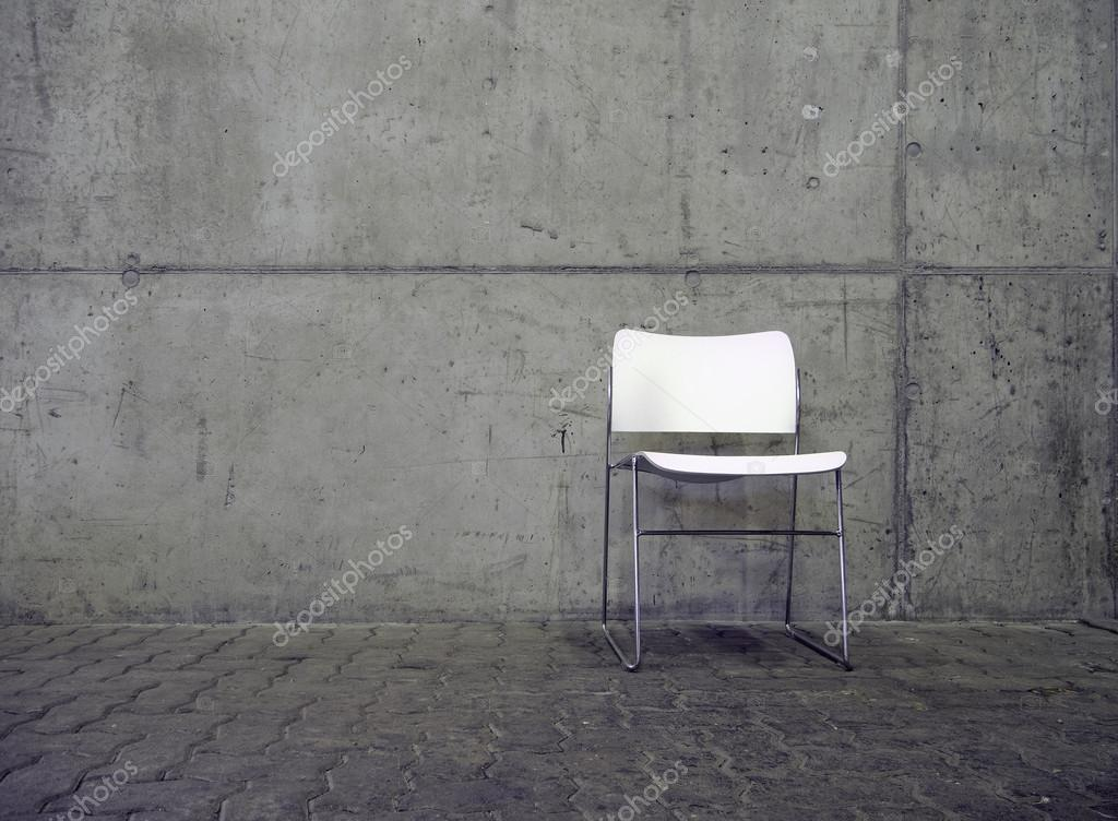 White chair and concrete wall
