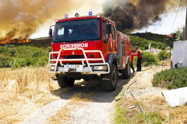 ALJEZUR - JULY 6: Firefighters fighting a huge bushfire in the national park near Aljezur on 6th july 2013 in Portugal