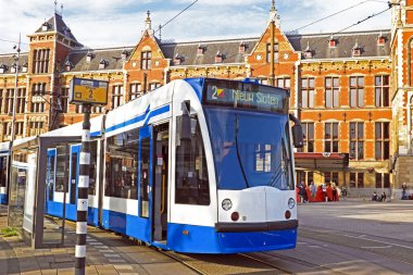 Tram waiting in front of the central station in Amsterdam the Ne