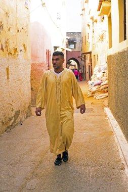 FES, MAROCCO - October 15 2013 : Man walking in the medina on Eid al-Adha.