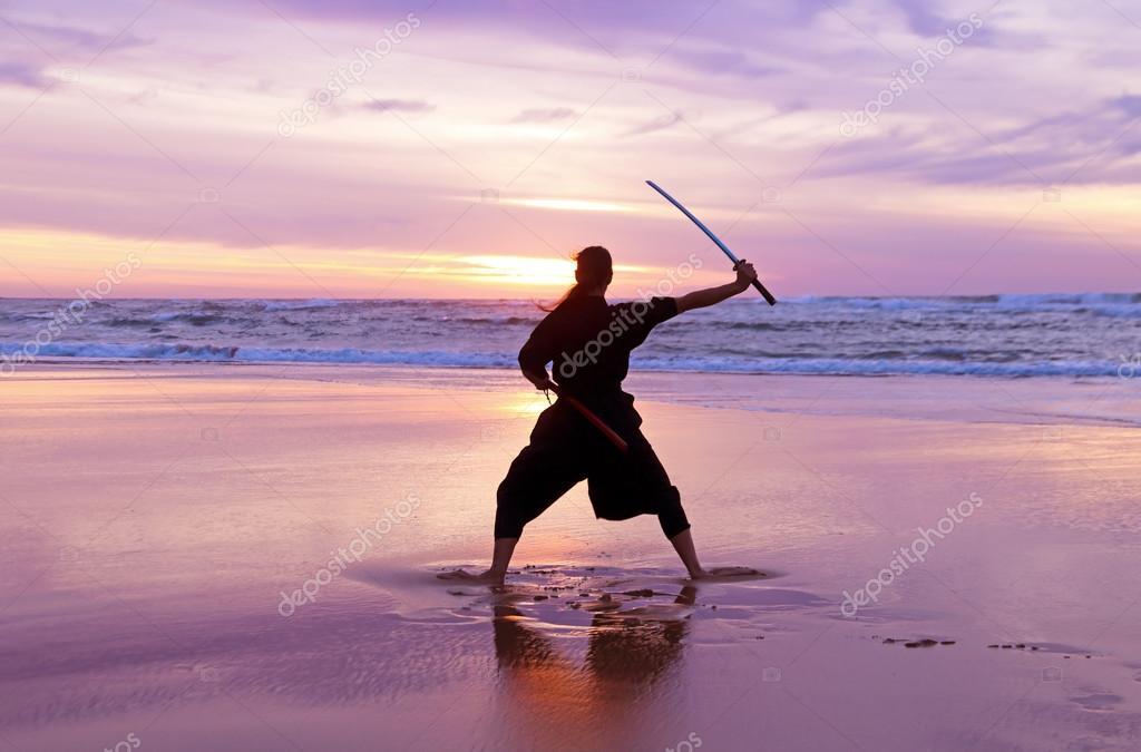 Young samurai woman on the beach