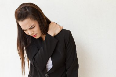 Heavy shoulder pain or stiffness of female business executive