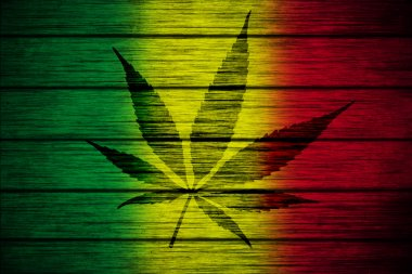 Background texture wood Rasta Flag with Marijuana Leaf silhouette